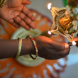 Hands lighthing oil lamp - Stock Photo