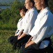 Three young aikido man — Stock Photo
