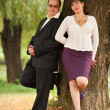 Young couple near a tree — Stock fotografie #3998950