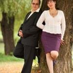 Young couple near a tree — Stock Photo