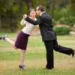Young couple dancing outdoor — Stock Photo #3998952