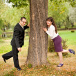 Young couple near a tree — Stock Photo