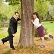 Stock Photo: Young couple near a tree