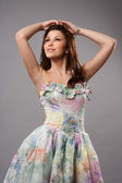 Attractive girl in colorful dress — Stock Photo