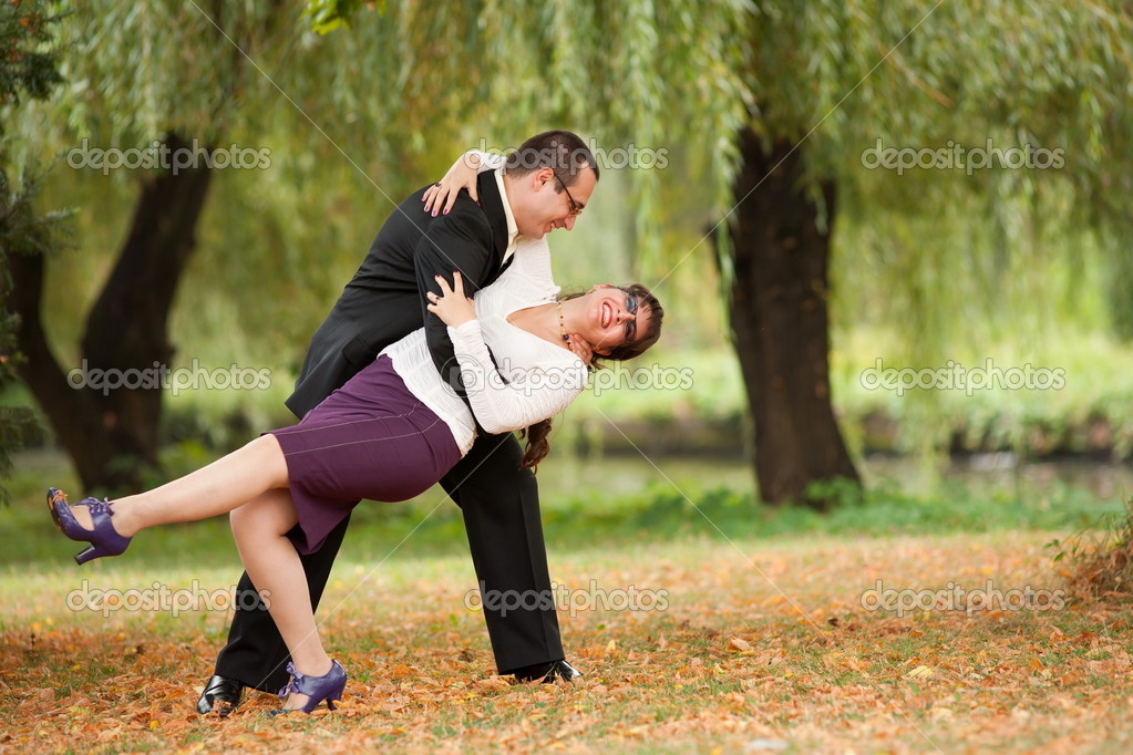Happy young couple dancing outdoor in a park — Stock Photo #3998949