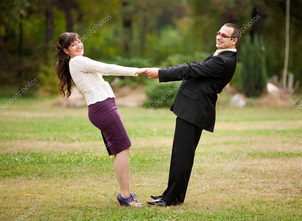 Happy young couple dancing outdoor in a park — Stock Photo #3998951