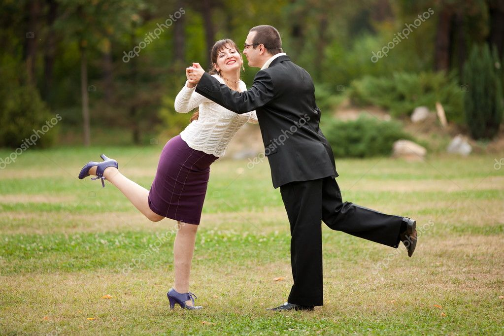 Happy young couple dancing outdoor in a park  Stock Photo #3998952