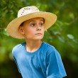 Country boy with hat outdoor — Stock Photo #4049194