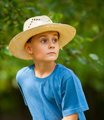 Country boy with hat outdoor — Stock Photo