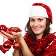 Santa girl with Christmas balls - Stockfoto