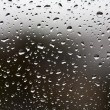 Rain drops on window glass - Stock Photo