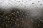 Gotas de chuva no vidro da janela — Foto Stock