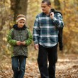 Stock Photo: Father and son taking walk outdoor