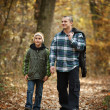 Father and son taking a walk outdoor - Stock Photo