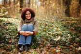 Young lady in the forest — Stock Photo