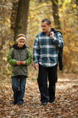 Father and son taking a walk outdoor — Stock Photo