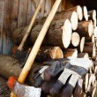 Axe, protective gloves and stack of logs - Stock Photo