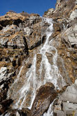 Waterfall in mountains — Stock Photo