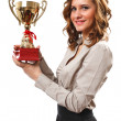 Businesswoman with golden cup — Stockfoto