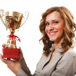 Businesswoman with golden cup — Stock Photo