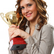 Stock Photo: Businesswomwith golden cup