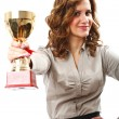 Businesswoman with golden cup — Stock Photo #4317955