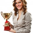 Businesswoman with golden cup - Photo