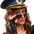 Sexy police officer woman with sunglasses — Stock Photo