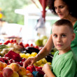 Shopping at farmers market - Stock Photo
