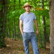 Young farmer with hat outdoor — Stock fotografie