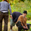 Stock Photo: Rural family harvesting plums