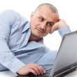 Relaxed businessman at his laptop — Stock Photo