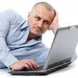 Relaxed businessman at his laptop — Stock Photo #4424281