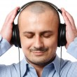 Businessman listening music - Stock Photo