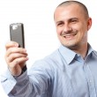 Businessman taking photos with cellphone — Stock Photo