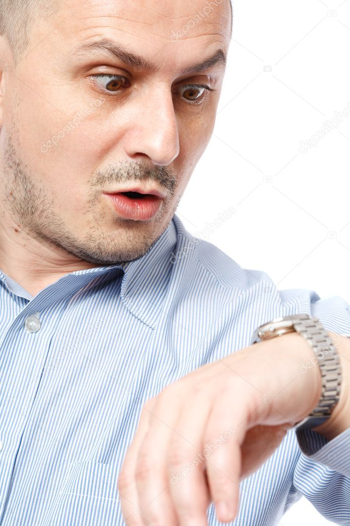 Young businessman worried looking at his wrist watch — Stock Photo #4424293