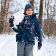 Happy kid playing in the snow - Stok fotoraf