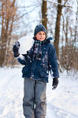 Happy kid playing in the snow — Stock Photo