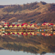Stock Photo: Houses by the lake
