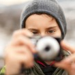 Little boy taking pictures outdoor — Stock Photo #4599049