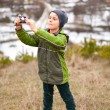 Little boy taking pictures outdoor — Stock Photo #4599052
