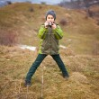 Little boy taking pictures outdoor — Stock Photo #4599054