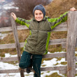 Kid sitting on wooden fence — Stock Photo #4599075
