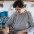 Senior woman cooking — Stock Photo #4602273