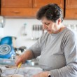 Senior woman cooking — Stock Photo #4602277