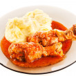 Dish with drumsticks and mashed potatoes — Stock Photo