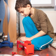 Boy playing with toys — Stock Photo #4798975