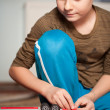 Boy playing with toys - Stock Photo