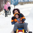 Family speeding on a sledge — Stock Photo #4880244