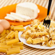 Macaroni with cheese and recipe ingredients - Stock Photo